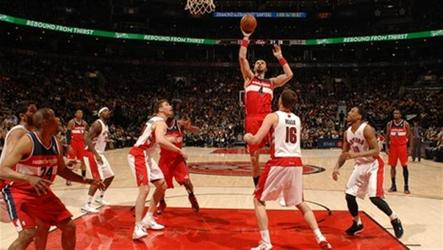 Marcin Gortat scored a career-high 31 points and 12 rebounds while John Wall added 31 points and nine assists as the Washington Wizards outlasted the Toronto Raptors in a thrilling triple-overtime victory.