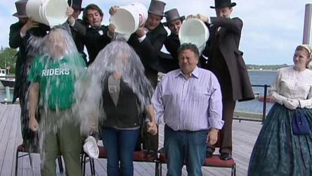 Premiers Darrell Pasloski of Yukon, Christy Clark of B.C. and Nunavut's Peter Taptuna take the ice bucket challenge after the premiers meeting in Charlottetown Friday.