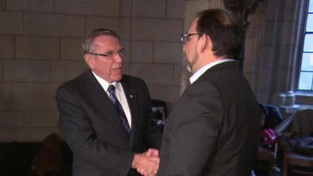 Conservative caucus chair Guy Lauzon and NDP caucus chair Glenn Thibeault shook hands for the cameras as MPs returned to their caucus rooms and tried to get back to normal one week after the Ottawa shootings.