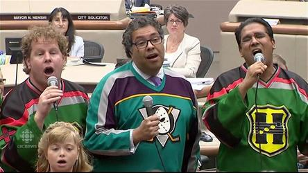 Calgary Mayor Naheed Nenshi makes good on his NHL bet by singing a song in council chambers