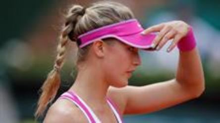 Kristina Mladenovic takes out Canada's Eugenie Bouchard in first round play at the French Open.