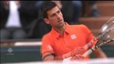 Novak Djokovic defeats Jarko Nieminen 6-2, 7-5, 6-2 and move to Round 2 of the French Open.