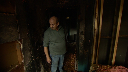 Don Yanew talks about the damage to his home following a fire at a construction site next door.